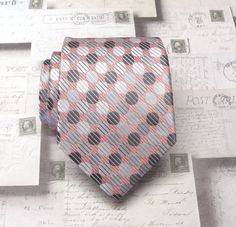 This tie is made of 100% silk, 3.50 wide at its widest point and 58 long - standard length and width. Hand rolled and sewn by hand.