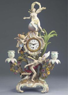 A Meissen porcelain mythological clock -   CIRCA 1880, BLUE CROSSED SWORDS MARK -   The central metal-mounted enamel dial surrounded by rocaille scrolls and flanked by a winged putto, raised on a tree trunk with large leaves and two flowering branches ending in candlestick holders, the front with Chronos or Father Time on rocaille quadruped base, the upper part with a scantily clad winged nymph on a celestial globe (including a key)  46.5 cm. high