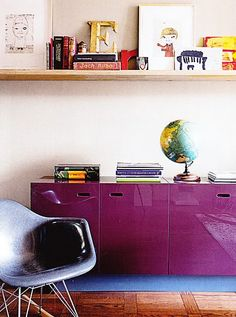 purple storage and great art arrangement on the shelf