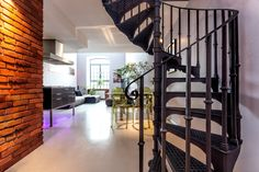 Spiral stairs and living room in modern loft — Photo by photographee.eu