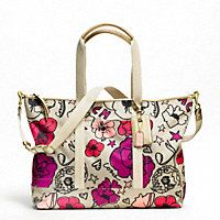 New Coach...KYRA FLORAL PRINT TRAVEL TOTE. I have a purse my boyfriend got me for valentines day in this exact print and I LOVE it. So I need this! Haha(:
