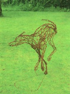 Rusted barbed wire and steel Stylized Animals #sculpture by #sculptor jo burchell titled: 'Wolfhound' #art