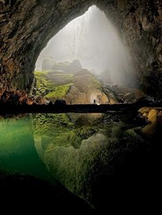 """Hang Son Doong Cave, Vietnam.    Hang Sơn Đoòng (meaning """"Mountain River cave"""" in Vietnamese) is a cave in Phong Nha-Kẻ Bàng National Park, Bố Trạch district, Quảng Bình Province, Vietnam. The cave is located near the Laos-Vietnam border. It has a large fast-flowing underground river inside.    Hang Sơn Đoòng was found by a local man named Hồ-Khanh in 1991. The local jungle men were afraid of the cave for the whistling sound it makes from the underground river."""