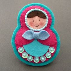 Matryoshka, broche ==could personalize these and give them as gifts.  A Matryoshka vet?, park ranger? oh the possibilities!!! Won't my family love this!