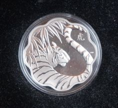 """Canada 2010 Year of the Tiger Chinese Lunar Zodiac $15 Lotus Shaped Silver Proof - A sensational rendering of a striped tiger, tail upraised, moving through the jungle. The Chinese character for """"Tiger"""" appears to the upper right. There are no legends on the obverse to detract from the power and the beauty of the dramatic design. Year Of The Tiger, 12 Zodiac, Chinese Characters, Chinese Zodiac, Coin Collecting, Lotus, Legends, Canada, Money"""