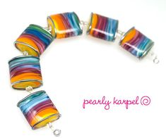 Colorful pillow lampwork beads SRA MTO set of 6,made by pearly karpel, Handmade lampwork glass beads, jewelry supplies artisan glass beads The set is 6 colorful vortex 21 mm pillow lampwork beads with metallic lines Handmade by me  The mandrels size is 1.5mm (1/16) All my beads are kiln annealed
