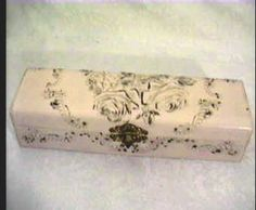 Victorian glove box, unusual soft pale pink tone, highly embossed, gold gilt roses, scrolling detail, celluloid is in exceptional condition, near perfect, interior pink satin lining, intact, appropriate aging, bright and complete original hardware    And phew, whoever wrote that is a great devotee of run on sentences...