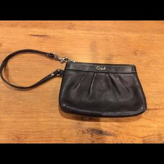 Black coach wristlet Authentic Black coach wristlet in excellent condition. Only used a few times.  VERY small stain on inside barley noticeable at all. (As seen in third picture). Outside is perfect condition. Perfect for use as a wallet or a wristlet for going out! Coach Bags Clutches & Wristlets