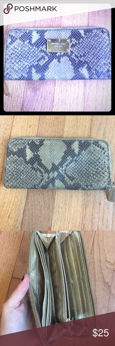 Michael Kors snake wallet Authentic Michael Kors snake skin, gold hardware wallet. Used condition but still lots of life left in it. Beautiful neutral color to match any handbag. Zip around and a lot of interior organization. Michael Kors Bags Wallets
