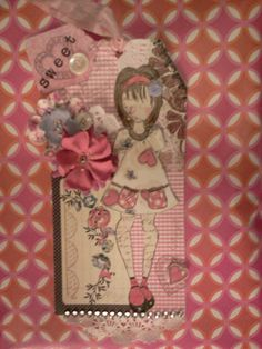Tag created in Julie Nutting class at GeeGee's in Carlsbad using her Prima Doll stamp and tags - by Carla Bange