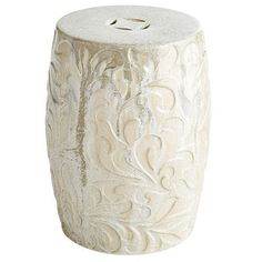 Antoinette brings the soft glow of moonlight to your home or garden. Molded by hand, each ceramic stool features an embossed scroll design and classic lucky-coin top detail. The pearlized ivory glaze imparts a subtle opalescent sheen.