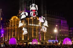 Turn on the Lights: De Bijenkorf Opens the Christmas season in Amsterdam. On Thursday, 21 November 2013, Amsterdam's luxury department store de Bijenkorf will give the start of the Christmas season with a magnificent festive light spectacle and theatrical performance by international street theatre company Plasticiens Volants.