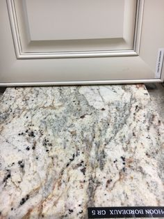 typhoon bourdeaux granite - Antique white with pewter glaze Adams cabinet with typhoon bourdeaux granite
