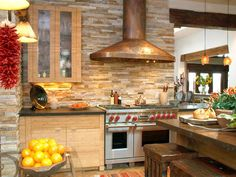 Rustic Stone Backsplash Stone: Quartzite Sandstone This textured, rustic backsplash makes it look as if this kitchen by Hamilton-Gray Design is fully constructed of stone. But, in fact, the quartzite material actually comes in pieces that are applied just like tile,