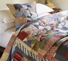 Love this quilt... I love anything that has that cabin/comfy/primitive feel to it!