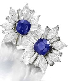 Harry Winston. A Pair of Sapphire and Diamond Ear Clips, by Harry Winston, c.1980s.