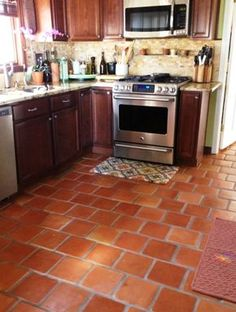 Get Saltillo Tile right from the source - Rustico Tile and Stone. We ship worldwide and offer discount prices for handmade Saltillo floor tile. Mexican Kitchen Decor, Mexican Kitchens, Kitchen Tiles, Kitchen Flooring, Brick Shelves, Terracotta Floor, Clay Tiles, Cool House Designs, Kitchen Remodel