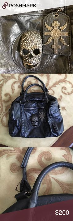 Thomas Wylde!!!! Black leather Thomas Wylde purse signature skull on the front and print inside, the strap is wearing down nothing a shoe repair shop couldn't fix but price will reflect please no trades Thomas Wylde Bags Shoulder Bags