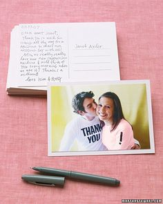 For a cute twist on personalized thank-you notes, send gift-givers postcards of you and your groom wearing clothing emblazoned with messages.