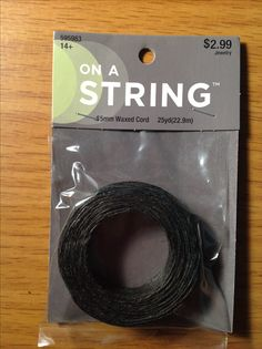On a String .65mm Waxed Cord - Black.  25 yds.  Hobby Lobby 11/12/2016  $1.49 ($1.57 = ~ $0.0025/in.)