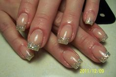 A very pretty yet professional French styled set. Love the warm pink on the nail bed.