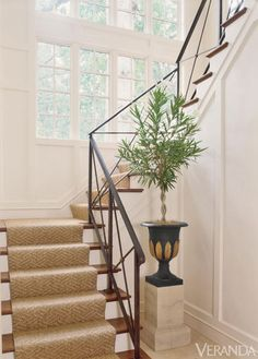 Added coffers, crowns, twelve-inch baseboards and elegant finishes gives depth to this space.  Custom railing. Stark stair runner. Image originally appeared in the January/February 2010 issue of VERANDA. INTERIOR DESIGN BY SUE BURGESS   - Veranda.com