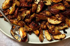 Mustard-Roasted Potatoes Recipe Side Dishes with vegetable oil spray, whole grain dijon mustard, extra-virgin olive oil, butter, fresh lemon juice, garlic cloves, dried oregano, grated lemon peel, kosher salt, potatoes