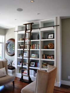 Fantasy library bookshelf with ladder...this one is perfect!!! White, with a colored background and moldings, with an antique rolling ladder....ahhhh!!!