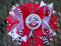 This boutique style bow can be purchased as pictured or can be customized. Please make send a message for changes (larger, different colors, etc.).  *high quality grosgrain ribbon *approximately 5 inc