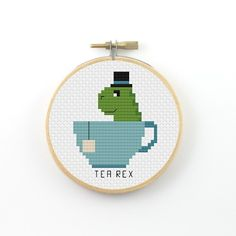 Tea Rex cross stitch pattern (instant download) ----------------------------------------------------- Pattern information: Fabric: 14 count Aida white Stitches: 42*42 Size: Width: 3 (7,6 cm) Height 3 (7,6 cm) 6 DMC Colors Used stitches : cross stitch and back stitch 2 PDFs Included: - preview image of the finished design - colour symbol chart - black and white symbol chart - color floss legend with DMC stranded cotton ----------------------------------------------------- Instant Do...