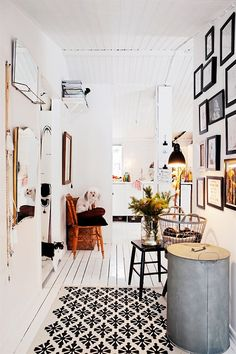 like the combination of white walls, funky decor, picture wall, rug.