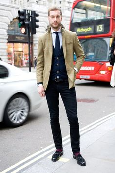 London Collections Men Street Style: Ben Curry, Harrods mens tailoring buyer - Wearing: Harrods own label jacket, Eton shirt, A. Sauvage tie, Nude jeans, Topman socks, and Mr Hare shoes.