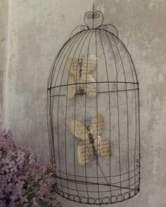 Make a faux wire cage and create your own book page butterflies or birds for an eye catching wall display!