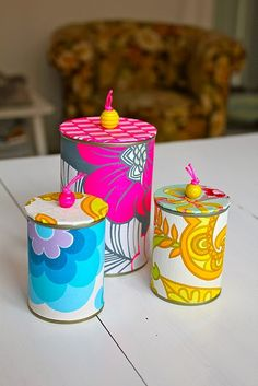 Tin cans covered in paper with cardboard and bead lids - upcycling, resulting in a beautiful (and useful) gift :)