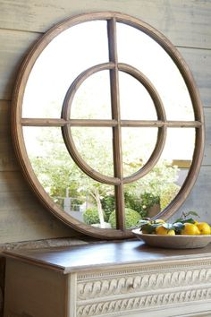 Eliseo Round Mirror - I totally want this, it would look great on the wall exactly opposite a giant round clock I have the same size