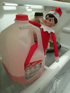 Day 14 - peek-a-boo tied a row from Santa to our milk and colored our milk pink. Silly elf!