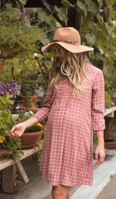 A trendy plaid lace-up up maternity top is the perfect transition tunic/dress! We love wearing it as a dress or as a tunic with maternity leggings and ankle booties for a complete look.