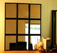 knock-off pottery barn mirror from framed dollar store mirrors - costs $10!