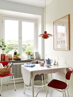 tiny scandinavian kitchen in white with red accents-not too country but just right!