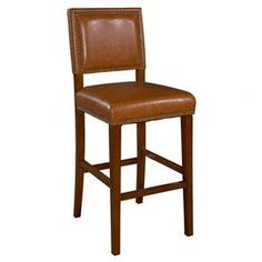 "Wood stool with a cushioned seat and nailhead trim.  Product: StoolConstruction Material: Rubberwood, foam and PVCColor: Brown and caramelFeatures: Padded seatDimensions: 40.5 - 45.5"" H x 19"" W x 22"" D"
