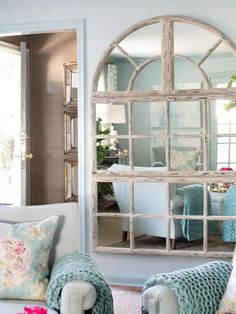 Oversized Mirror in 13 Ways to Make a Small Living Room Look Bigger from HGTV. Now i just have to find one :)