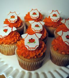 Fall Baby Shower Cupcakes. White frosting piped on with big circle tip, cream cheese frosting, pumpkin spice cake, orange cupcake liners.
