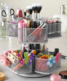 Banish clutter and disorganization with this powder-coated makeup carousel that organizes, stores and displays a variety of brushes, bottles, accessories and more. The spinning base ensures easy access to every item.8.5'' H x 9'' diameterPowder-coated steelWipe cleanImported...