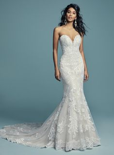 385d74d666 Maggie Sottero Bridal style name Luanne. Strapless deep V sheath lace  wedding dress. Currently