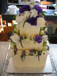 3-tier WIcked chocolate wedding cake, white chocolate tiles , white & purple flowers by Charly's Bakery, via Flickr