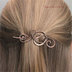 This small hair barrette is made from a sturdy pure copper wire which has been antiqued, hammered and polished. It has been curved by hand and a flowing wire wrapped swirl has been added securely. Small but mighty, this little elegant hair piece is suitable for thin fine hair as well as a portion of thick hair. It is also beautiful as a shawl pin   Measurements:   Length 2 1/2 X 1 1/4 at the widest point. (6.4cm X 3.2cm). The stick is included and measures about 1 1/2 longer th...