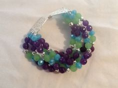 Hey, I found this really awesome Etsy listing at https://www.etsy.com/listing/191232262/multi-strand-purple-and-green-bracelet