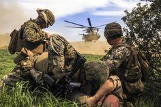 Marines protect a simulated injured person from the rotor wash of a CH-53E Super Stallion helicopter during a tactical recovery of aircraft and personnel training scenario on Camp Pendleton, Calif., Feb. 10, 2016. The Marines are with Weapons Company, 2nd Battalion, 4th Marine Regiment. Marine Corps photo by Lance Cpl. Devan K. Gowans