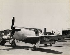 New Jersey National Guard 108th Fighter Group Captain Peterson and Staff Sergeant Iglio making check of P-47 aircraft before takeoff, circa 1939-1945