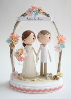 @Crystal Chou Westerwal  OMG how adorable is this? you can get it in purple and its soooo adorable. Its customizable so they make it to match your dress and bouquet and his suit etc.   custom beach wedding cake topper  with arch by lollipopworkshop, $190.00